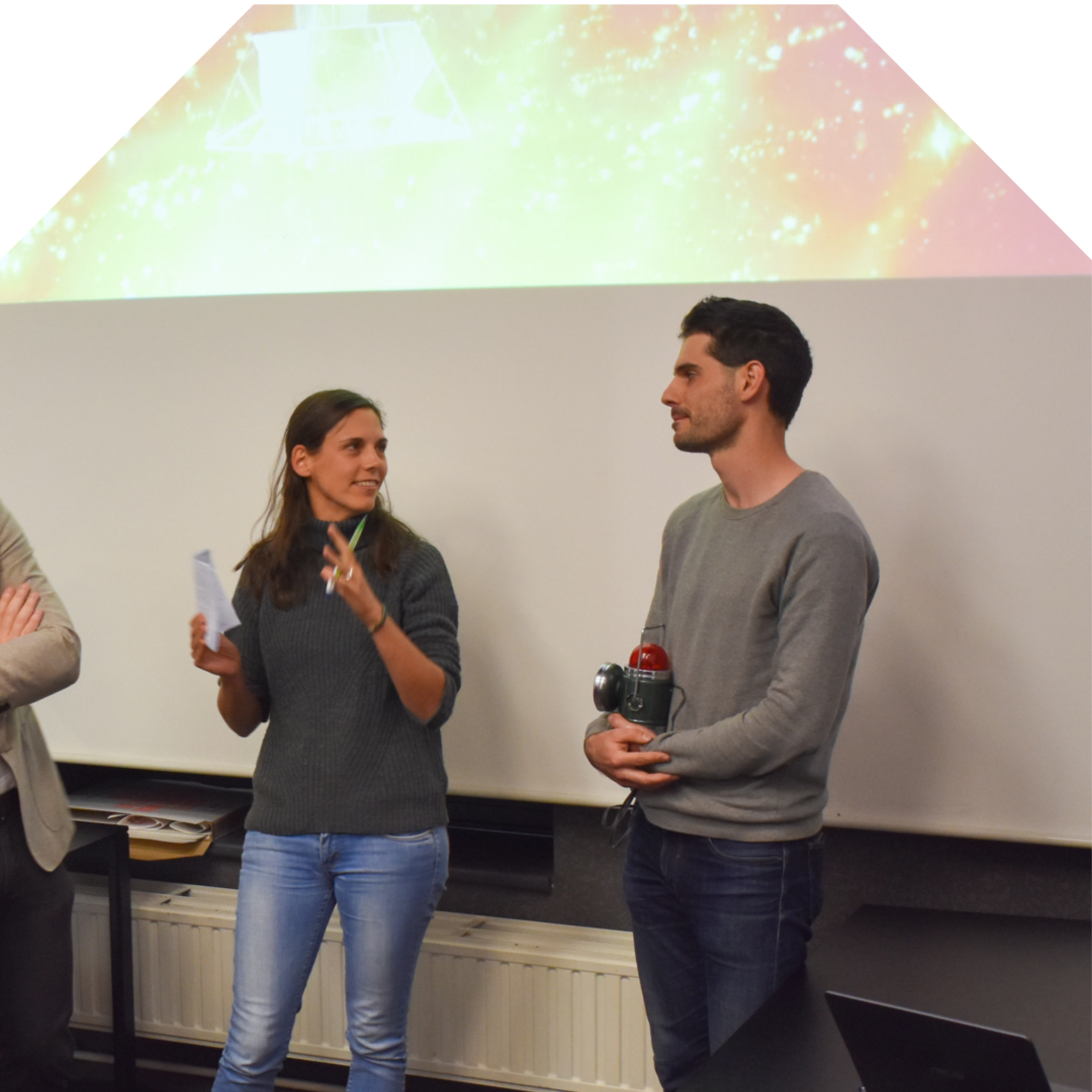Guillaume receiving the first prize from Lena Weissert ‏from University of Auckland